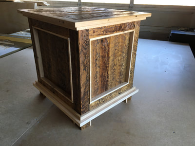 Here's a view showing the the panels of the rustic and modern enclosed end table. The  end table is made of reclaimed pine and maple wood.