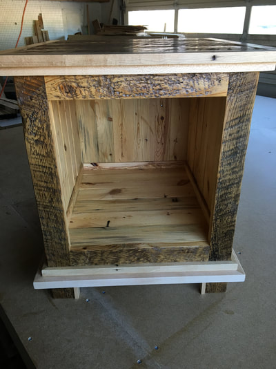 Front view of the modern and rustic enclosed end table made with reclaimed pine and maple wood.