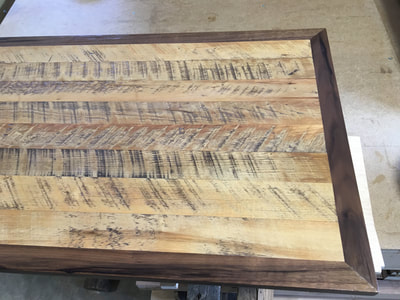 Top of the cottonwood trunk. Shows rough cut cottonwood reclaimed wood and eastern rustic walnit.