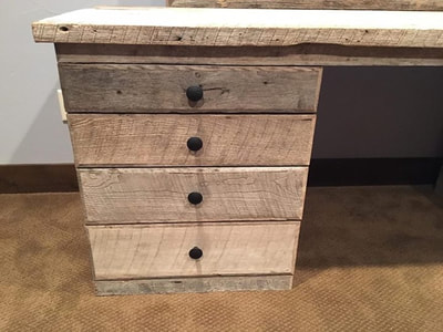Left side drawer stack of the modern gray reclaimed wood Hollywood vanity. This image features the drawer fronts and knobs.