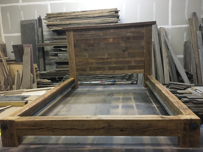 Front view of the reclaimed wood beam bed frame.