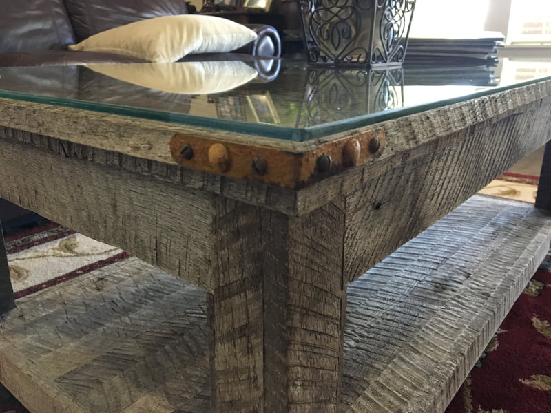 Detail shot of the corner bracket used on the antique wheel and gray reclaimed coffee table.
