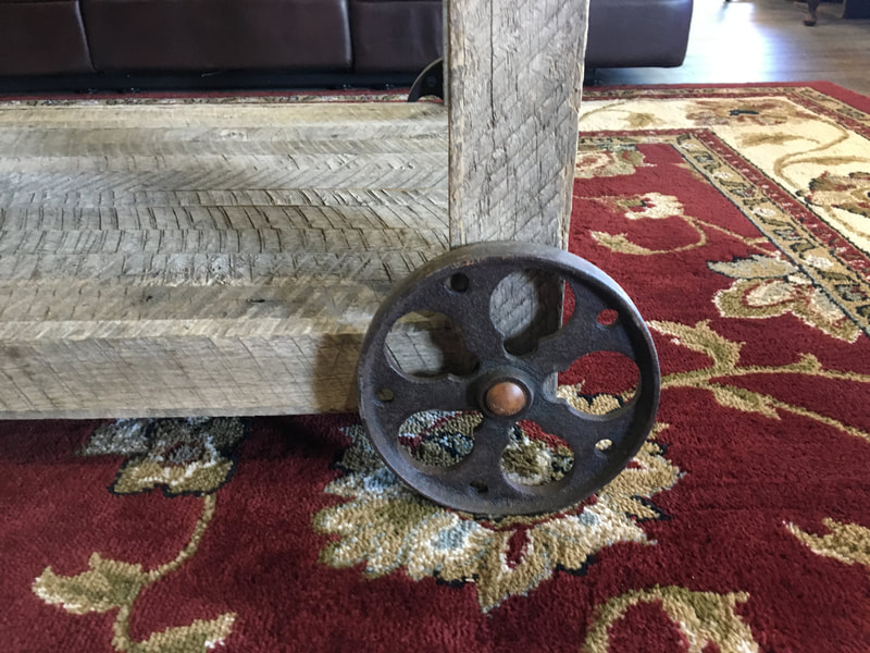 Detail shot of the wheel used on the antique wheel and gray reclaimed coffee table.