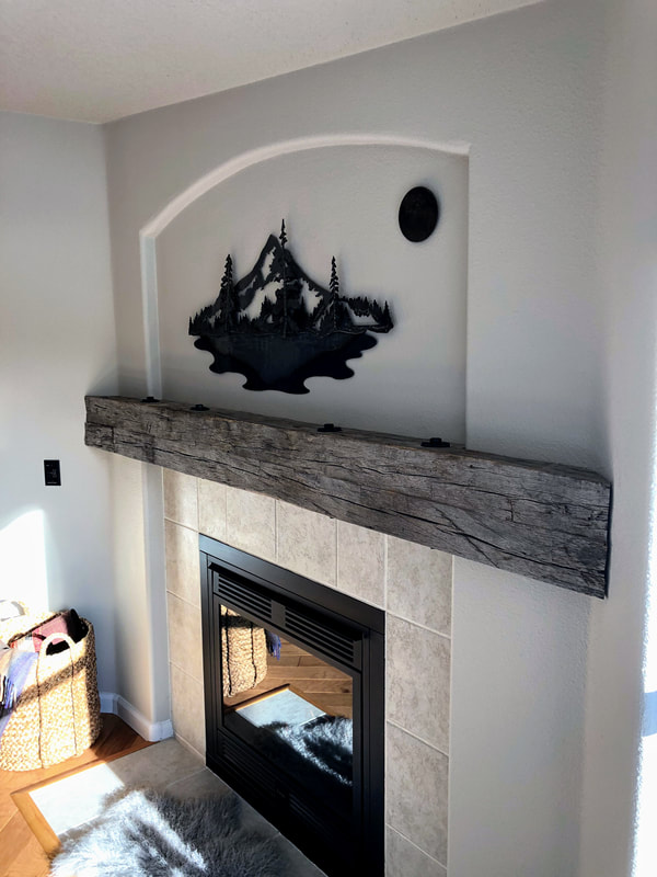 Right side view of he entire gray hand hewn white oak mantlepiece.