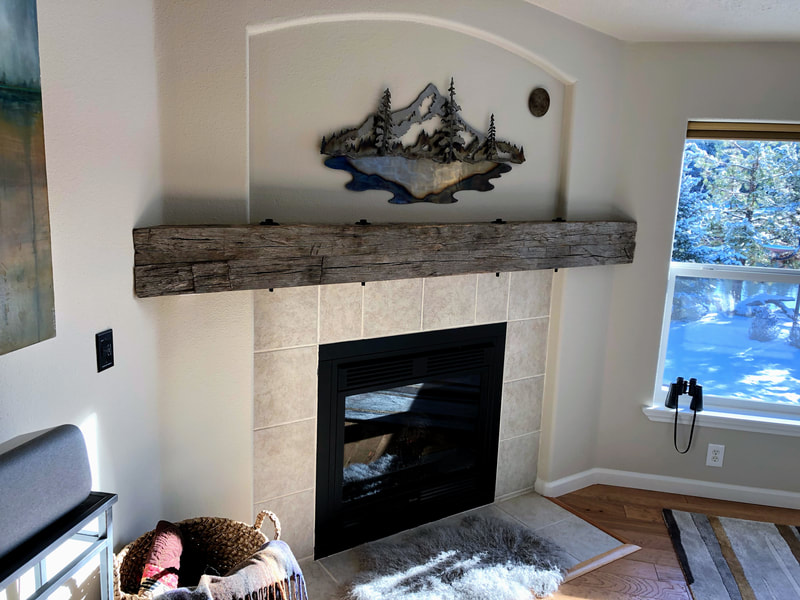 This shows the entire gray hand hewn white oak mantlepiece.